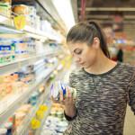 allergen control woman reads label