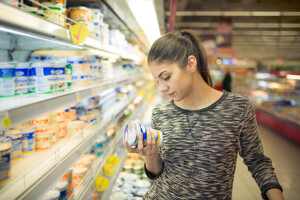 allergen control woman reads label